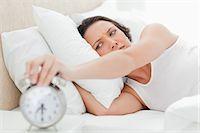 ring hand woman - Woman turning off her alarm clock Stock Photo - Premium Royalty-Freenull, Code: 6109-06194166