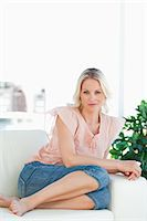 Portrait of a blonde housewife on a sofa Stock Photo - Premium Royalty-Freenull, Code: 6109-06195004