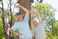 Smiling elderly man and woman are stretching outdoors Stock Photo - Premium Royalty-Freenull, Code: 6109-061