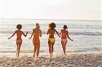 Four women running into the water Stock Photo - Premium Royalty-Freenull, Code: 6109-06195645