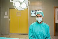 Nurse wearing a surgical cap and a mask Stock Photo - Premium Royalty-Freenull, Code: 6109-06195772