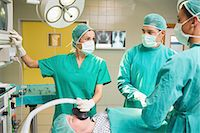 Surgeons looking at the monitor Stock Photo - Premium Royalty-Freenull, Code: 6109-06195808