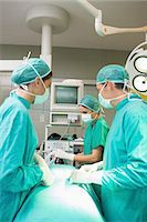 Side view of a surgical team Stock Photo - Premium Royalty-Freenull, Code: 6109-06195816