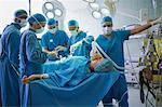 Group of hospital surgeons operating a patient