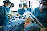Unconscious patient being operated by surgeons