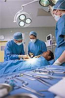 Operation being done on a patient in an operating theater Stock Photo - Premium Royalty-Freenull, Code: 6109-06196030