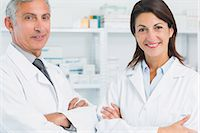 Smiling pharmacists with their arms folded Stock Photo - Premium Royalty-Freenull, Code: 6109-06196139