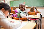 Pupil turning around during lesson Stock Photo - Premium Royalty-Free, Artist: Uwe Umstätter, Code: 6109-06196416