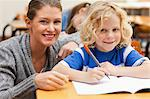 Student getting help from his teacher Stock Photo - Premium Royalty-Free, Artist: CulturaRM, Code: 6109-06196488