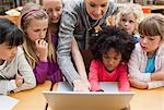 Teacher explaining laptop to students Stock Photo - Premium Royalty-Free, Artist: Jim Craigmyle, Code: 6109-06196548