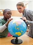 Teacher explaining globe to a student Stock Photo - Premium Royalty-Free, Artist: Aflo Sport, Code: 6109-06196557