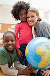 Smiling students with teacher next to globe Stock Photo - Premium Royalty-Free, Artist: CulturaRM, Code: 6109-06196560
