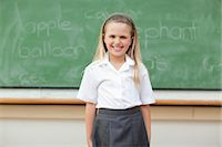 school girl uniforms - Girl standing in front of blackboard Stock Photo - Premium Royalty-Freenull, Code: 6109-06196567