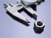 vernier calipers measuring a nut. Stock Photo - Premium Royalty-Freenull, Code: 679-06198268