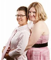 Caucasian lesbian couple embracing over white background Stock Photo - Royalty-Freenull, Code: 400-06204565