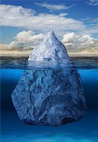 Iceberg floating in blue ocean, global warming concept Stock Photo - Royalty-Freenull, Code: 400-06204763