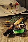 Fishing reel and hat on bench Stock Photo - Royalty-Free, Artist: Sandralise                    , Code: 400-06208117