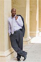 Portrait of Businessman Leaving Against Column Stock Photo - Premium Rights-Managednull, Code: 700-06282128