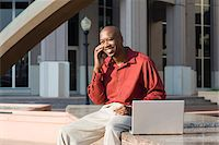 Man with Laptop and Cell Phone Stock Photo - Premium Rights-Managednull, Code: 700-06282131