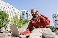 Businessman with Laptop and Cell Phone Stock Photo - Premium Rights-Managednull, Code: 700-06282136