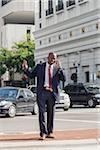 Businessman on Cell Phone in Urban Setting Stock Photo - Premium Rights-Managed, Artist: Kevin Dodge, Code: 700-06282138