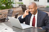 Businessman with Laptop and Cell Phone Stock Photo - Premium Rights-Managednull, Code: 700-06282141