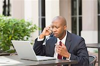 Businessman with Laptop and Cell Phone Stock Photo - Premium Rights-Managednull, Code: 700-06282142