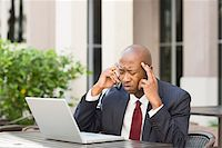 Stressed Businessman with Laptop and Cell Phone Stock Photo - Premium Rights-Managednull, Code: 700-06282143