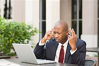 Stressed Businessman with Laptop and Cell Phone Stock Photo - Premium Rights-Managednull, Code: 700-06282144