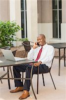 Businessman with Laptop and Cell Phone Stock Photo - Premium Rights-Managednull, Code: 700-06282145