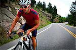 Cyclist Riding Bike on Road Stock Photo - Premium Rights-Managed, Artist: ableimages, Code: 822-06302352
