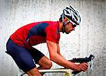 Profile of Cyclist Riding Bike Stock Photo - Premium Rights-Managed, Artist: ableimages, Code: 822-06302356