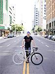 Man with Bicycle in City Road Stock Photo - Premium Rights-Managed, Artist: ableimages, Code: 822-06302367