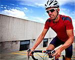 Cyclist Riding Bike Stock Photo - Premium Rights-Managed, Artist: ableimages, Code: 822-06302397