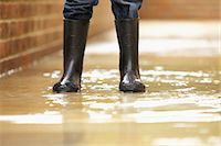 Boy's Legs in Wellington Boots on Flooded Pavement Stock Photo - Premium Rights-Managednull, Code: 822-06302398