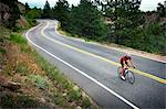 Cyclist Riding Bike on Road