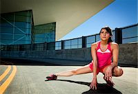 stretching (people exercising) - Young Woman Stretching Outdoors Stock Photo - Premium Rights-Managednull, Code: 822-06302417