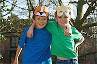 Two Smiling Boys Wearing Animal Masks on Forehead Stock Photo - Premium Rights-Managednull, Code: 822-06302420