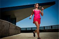 Young Woman Running Outdoors Stock Photo - Premium Rights-Managednull, Code: 822-06302427