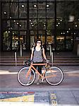 Woman with Bicycle in front of Office Building Stock Photo - Premium Rights-Managed, Artist: ableimages, Code: 822-06302445