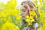 Profile of Young Woman amongst Canola Flowers Stock Photo - Premium Rights-Managed, Artist: ableimages, Code: 822-06302454