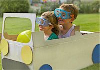 Boy and Girl Wearing Goggles Driving Cardboard Car Stock Photo - Premium Rights-Managednull, Code: 822-06302460