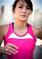 Close up of Young Woman Running Outdoors Stock Photo - Premium Rights-Managednull, Code: 822-06302506