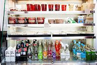 fridge - Shop Refrigerator Shelves Stacked with Food Containers and Soft Drink Bottles Stock Photo - Premium Rights-Managednull, Code: 822-06302515