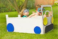 Boy and Girl Wearing Goggles Driving Cardboard Car Stock Photo - Premium Rights-Managednull, Code: 822-06302528