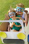 Boy and Girl Wearing Goggles Driving Cardboard Car Stock Photo - Premium Rights-Managed, Artist: ableimages, Code: 822-06302529