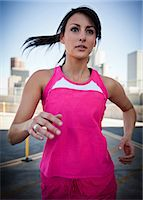 Young Woman Running Outdoors Stock Photo - Premium Rights-Managednull, Code: 822-06302538