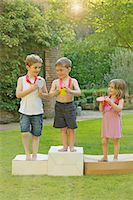Children Standing on Cardboard Podium with Medals Stock Photo - Premium Rights-Managednull, Code: 822-06302541