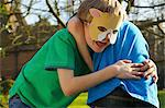 Boy Wearing Cat Mask Fighting with Friend Stock Photo - Premium Rights-Managed, Artist: ableimages, Code: 822-06302644