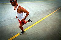 runner (male) - Man Running on Urban Road Stock Photo - Premium Rights-Managednull, Code: 822-06302657